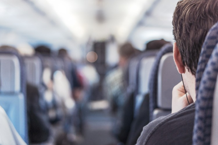 Airline passenger looks down the aisle