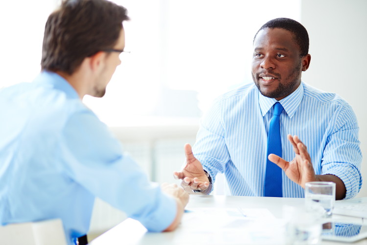 Man communicates expressively in interview