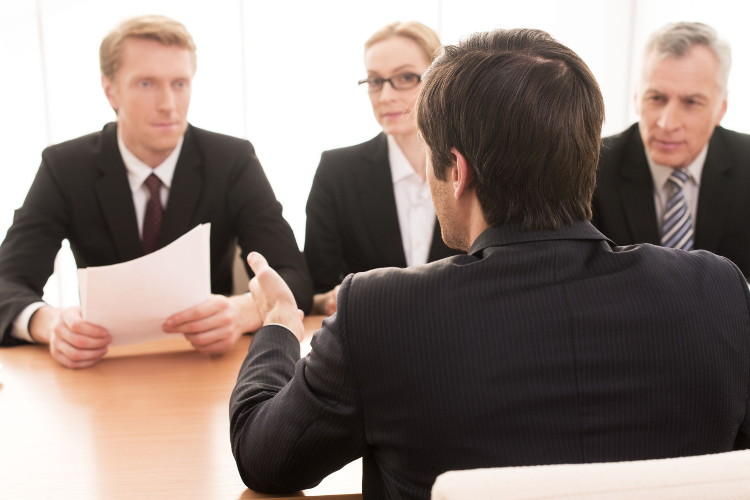 Interviewers listen as candidate answers