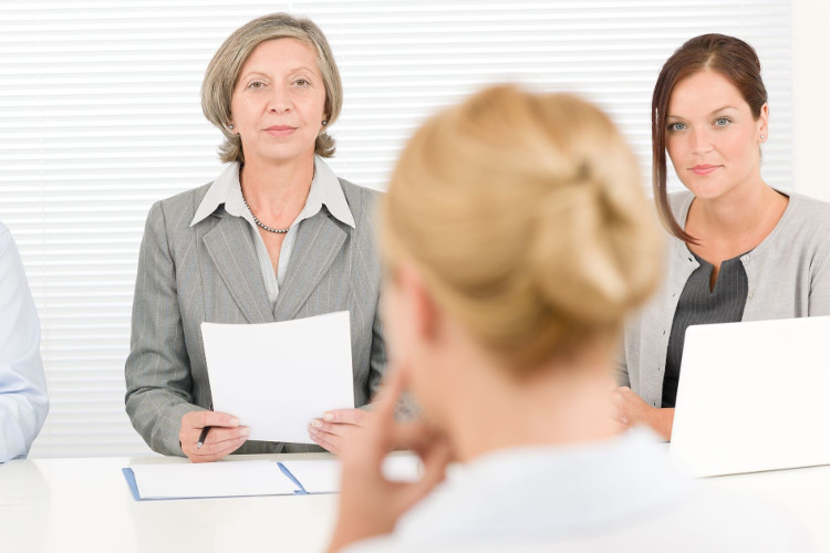 Employers wait for candidate to answer interview question