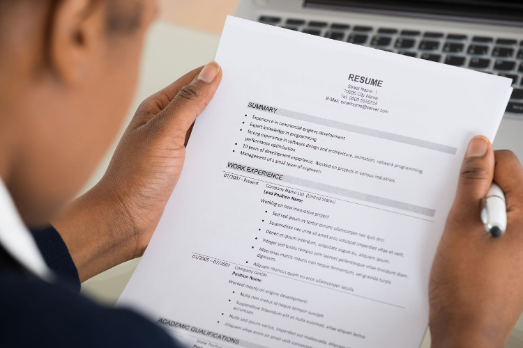 Employer reviews a candidate resume