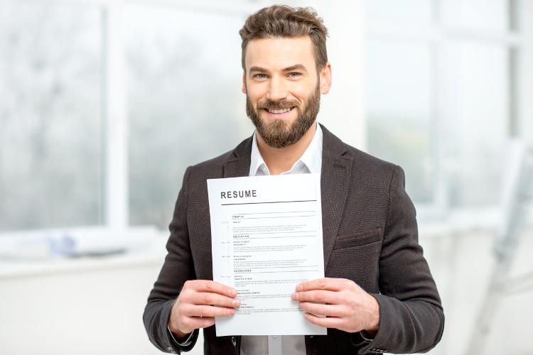 Job seeker holding resume